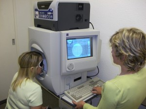 Julie and Tracy demonstrating the Humphrey Visual Field Analyser